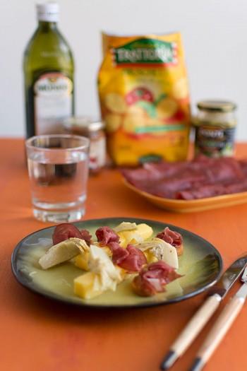Recette d'Italie : polenta, artichauts, sauce arrabbiata, bresaola